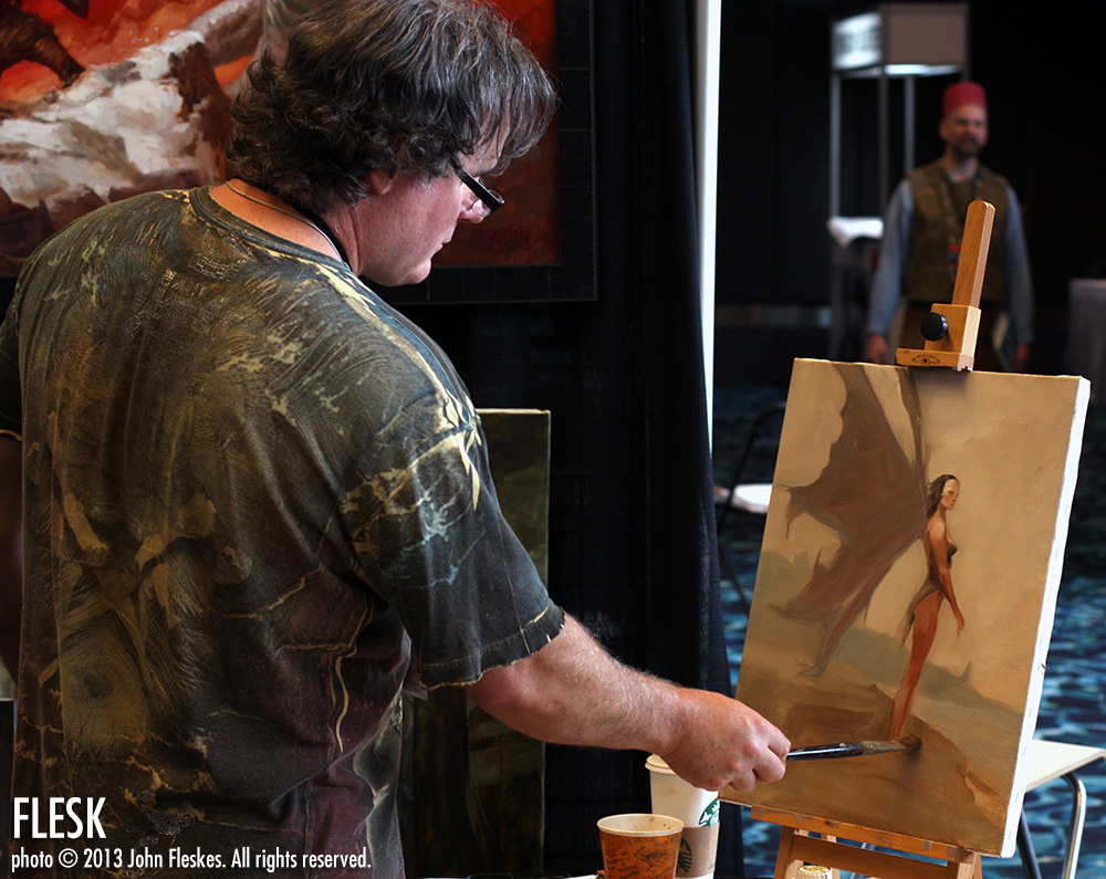 Over 200 artists will be exhibiting at Spectrum Fantastic Art Live 3. Here, Justin Sweet paints at his booth at SFAL2.