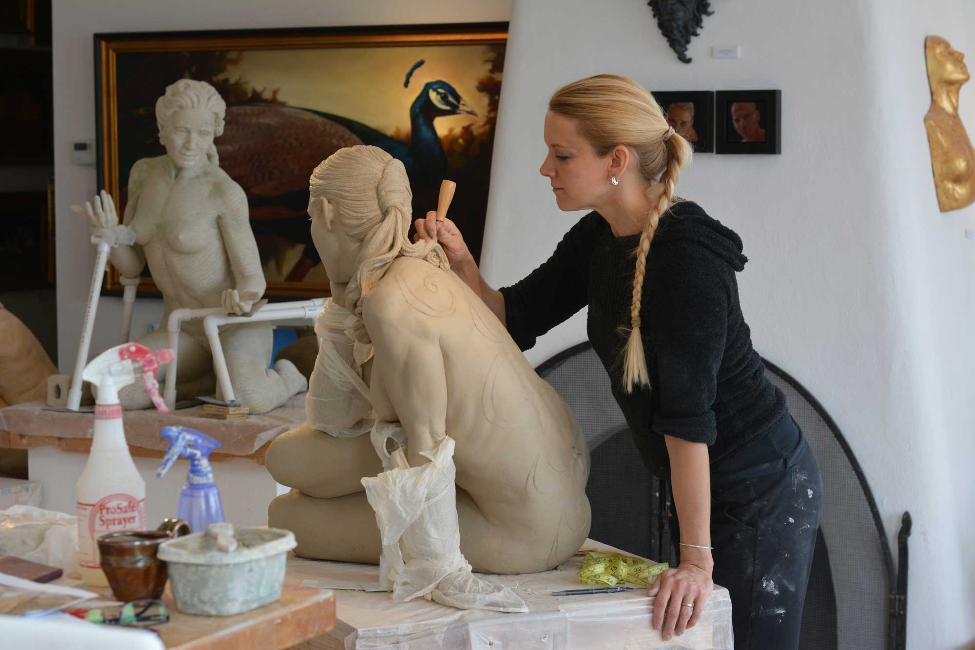 Kristine Poole working on one of her latest works.