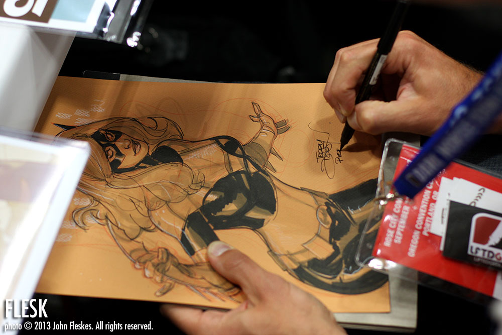 Terry Dodson working on a sketch for a show attendee.
